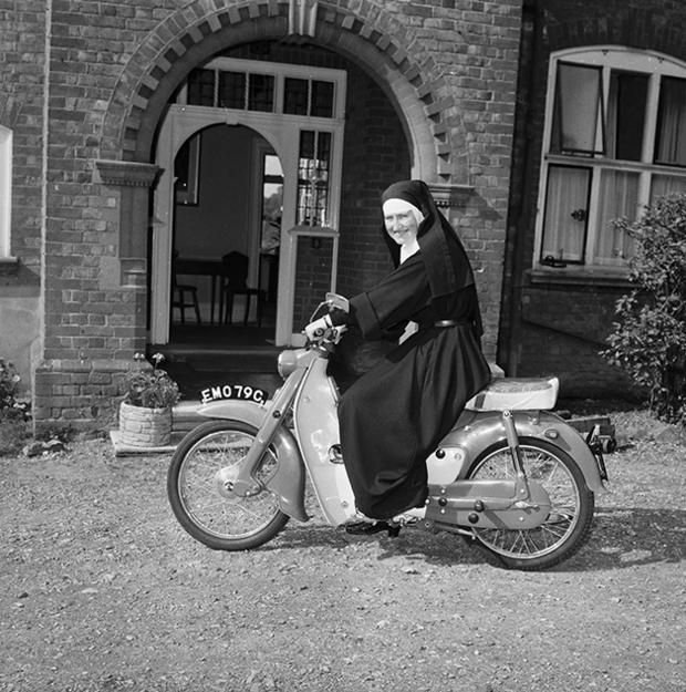 24th September 1965:  Sister Mary Bernadette, an ex-WAAF and now a nun of St John's Convent, Twyford, Berkshire on her motorcycle.  (Photo by Express/Express/Getty Images)
