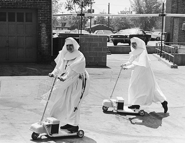 Sister Mary Thomas (right), an administrator at St Elizabeth's Hospital, convinces another nun of the convenience of an electric scooter, circa 1955. (Photo by Three Lions/Hulton Archive/Getty Images)