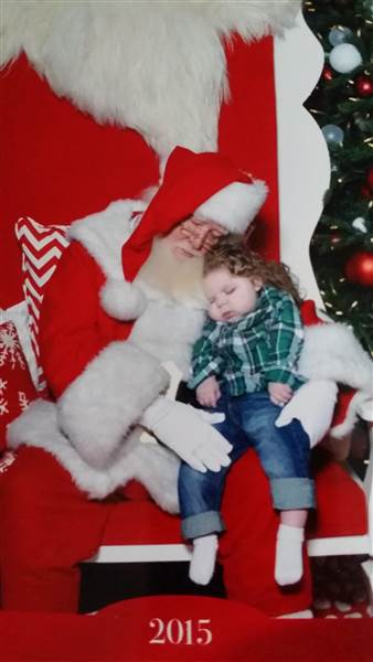 ryland_with_santa_41ceec6eefbb98de99c6e86329b89093.today-inline-large